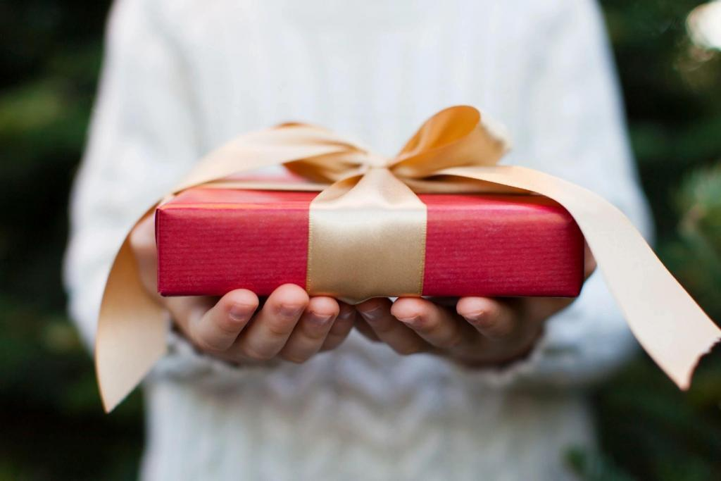 Man-Holding-Red-Present